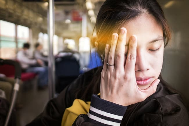 exhausted woman on train