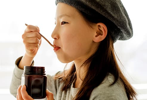 Girl eating honey