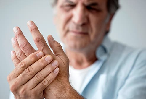 man with arthritis in hand