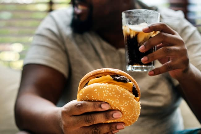 photo of man eating burger