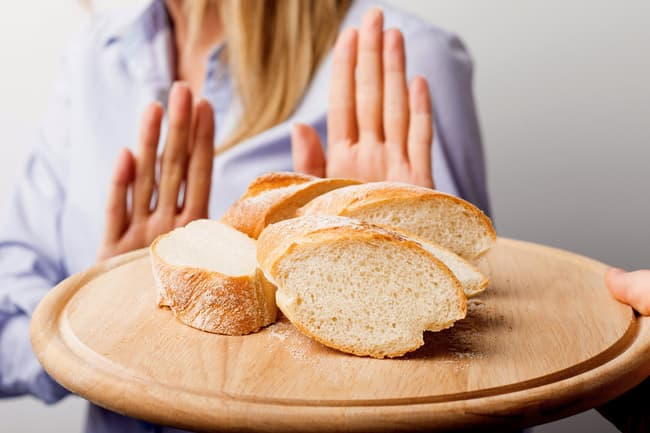 photo of woman pushing away bread
