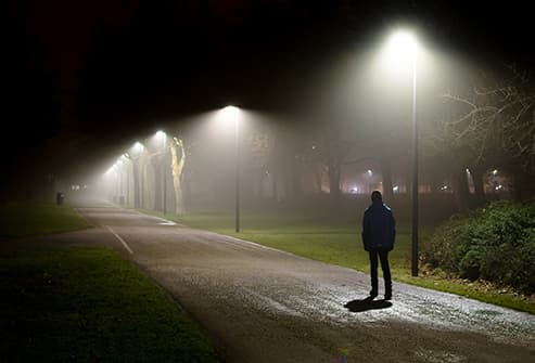 person walking at night