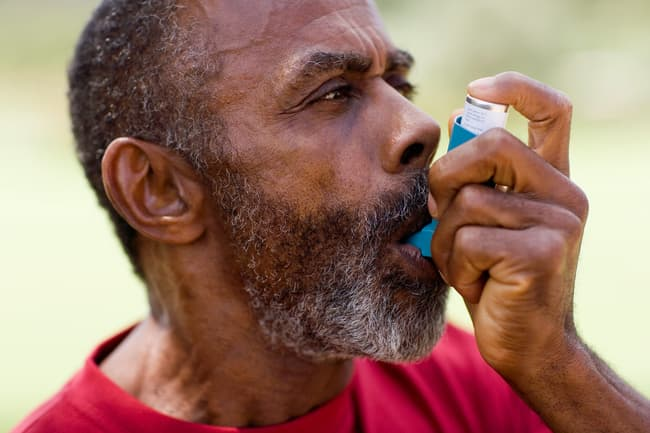 photo of mature man using an inhaler