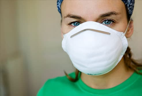 Woman wearing dust mask, portrait, close-up