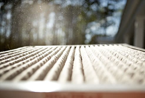 Air filter with dust particles above