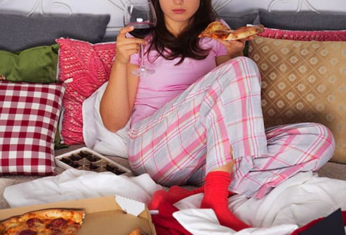 woman with wine and pizza