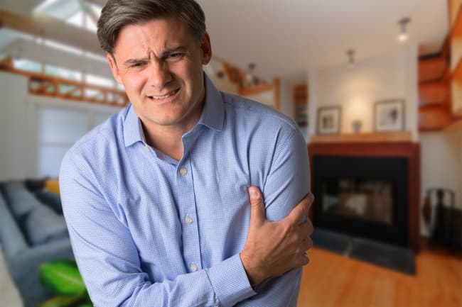 photo of man with arm pain