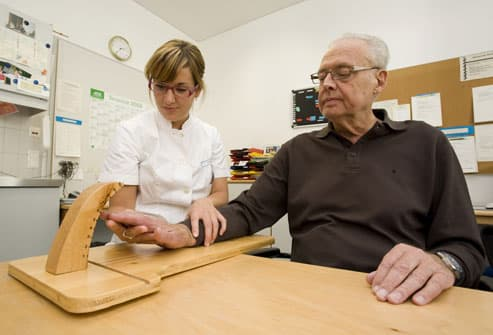 older man with occupational therapist