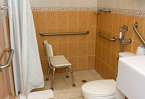 bathroom equipped with assistive bars