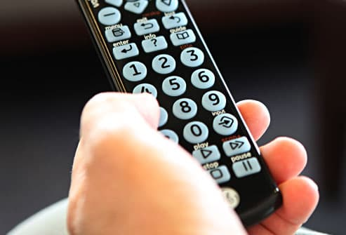 man holding remote with big buttons
