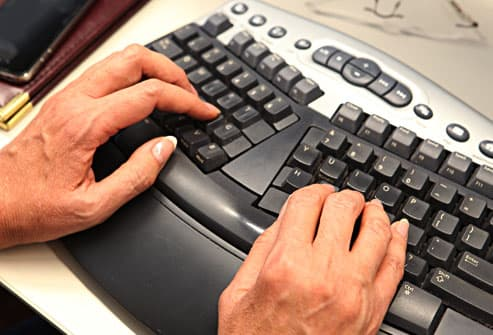 woman using ergonomic keyboard in office