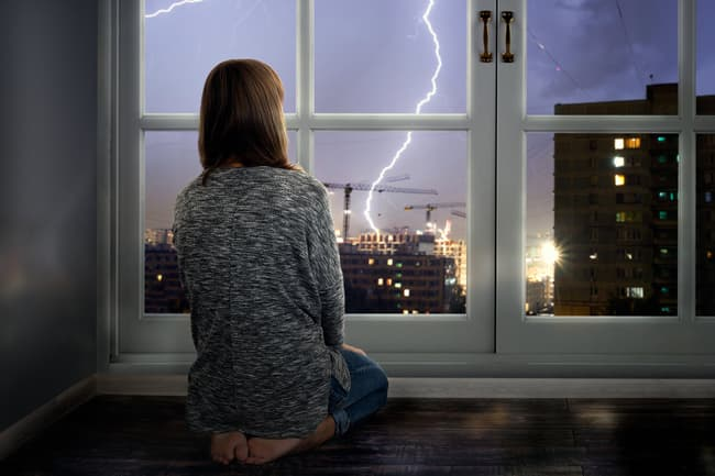 girl watching storm