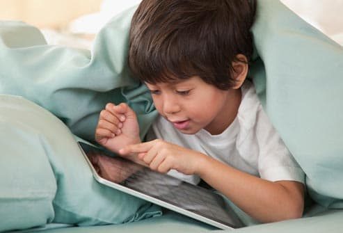 child playing with digital tablet