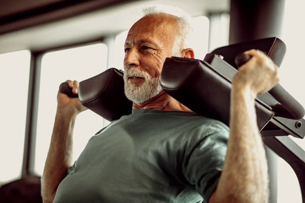 photo of mature man working out