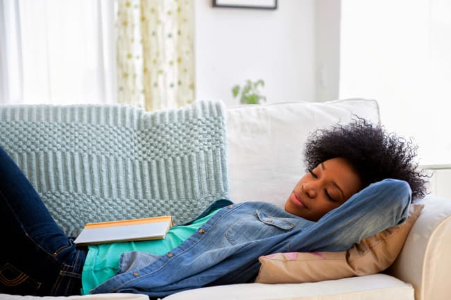 photo of woman napping on couch