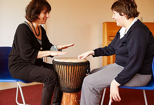 caregiver and woman drumming
