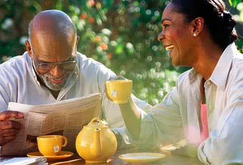 Senior couple enjoying herbal tea outdoors