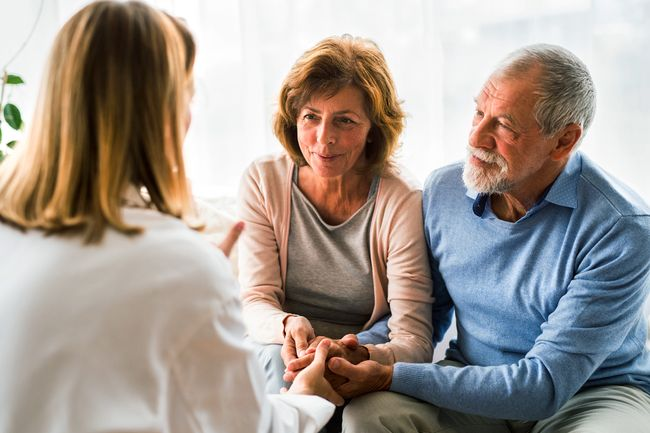 doctor talking to a senior couple
