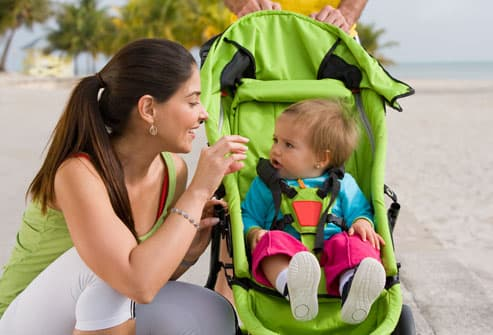 Mom Talking to Baby in Stroller