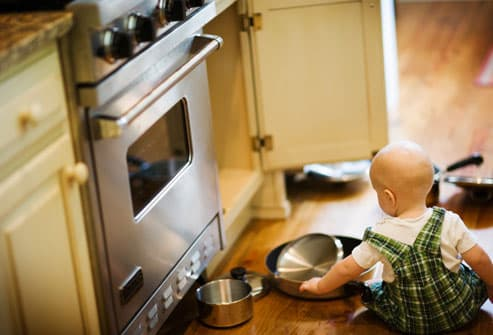 Baby Playing on Kitchen Floor