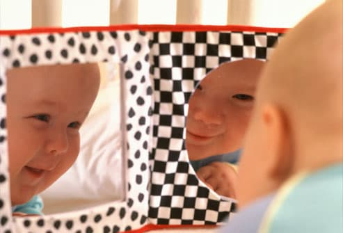 Baby Laughing at Reflection in Mirror
