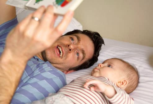 Daddy Reading to Baby Girl
