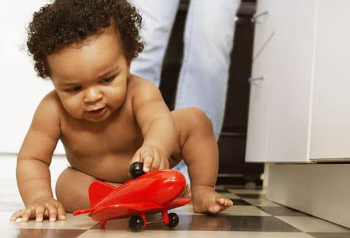 Baby Playing With Toy Airplane