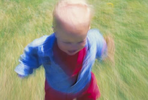 Boy toddler running (blurred motion)