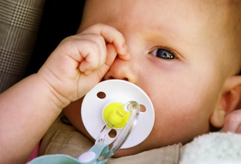 photolibrary rm photo of baby rubbing eye - YOUR BABY SUDDENLY WAKE UP AT NIGHT