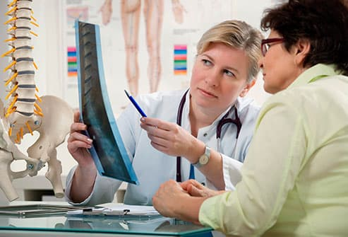 doctor reviewing spine scan