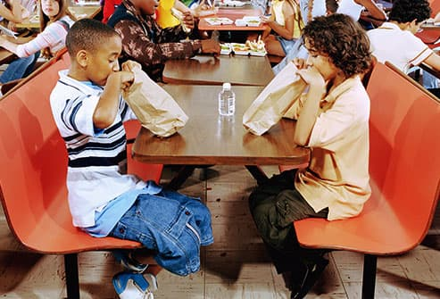 boys eating in a cafeteria