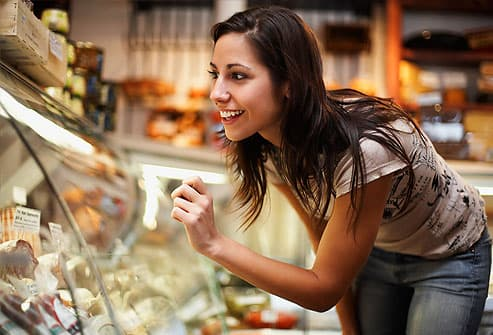Woman Looking in Deli Display Case