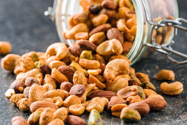 photo of mixed nuts spilling from jar