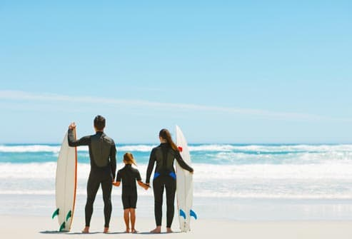 family with surfboards