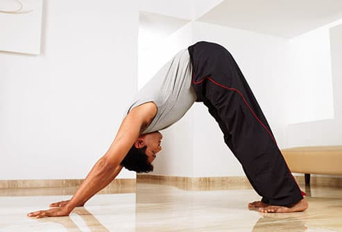 man doing downward dog