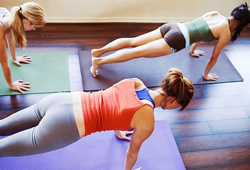 women doing plank pose