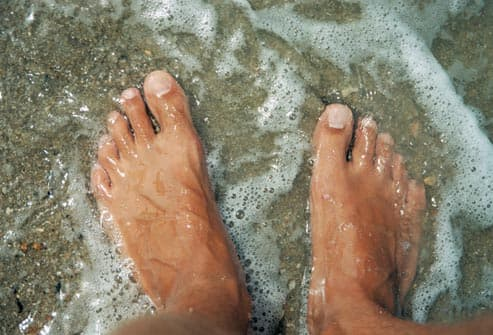 mans feet in water