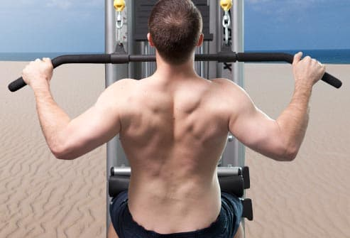 man demonstrating lat pulldown