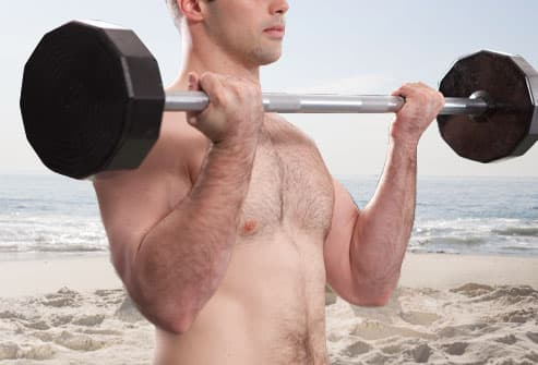 man demonstrating barbell curl