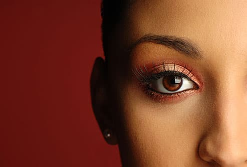 brown eyed woman with rusty eye shadow