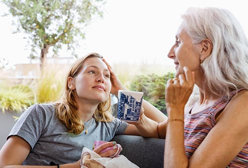 senior woman chats with daughter