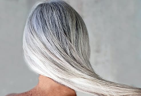 woman with long mane of silver hair