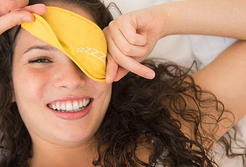 woman wearing sleep mask - The Benefits of Beauty Sleep