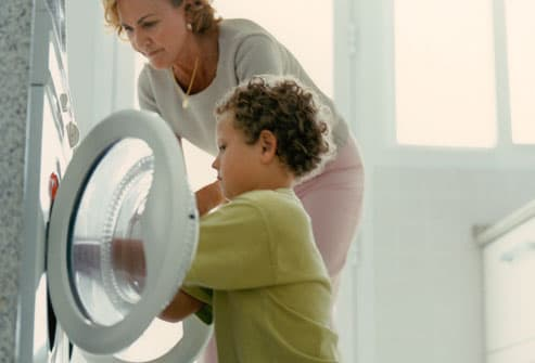 Mom Helping Son Do Laundry