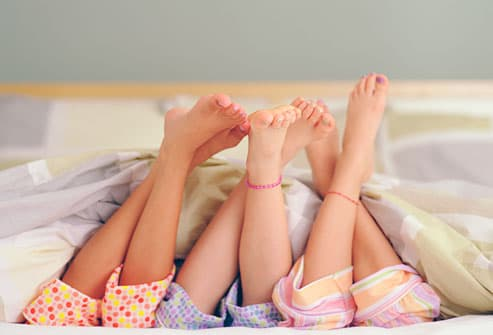 Girls Laying On Bed