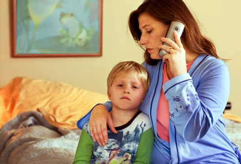 Worried Mom on Phone With Doctor