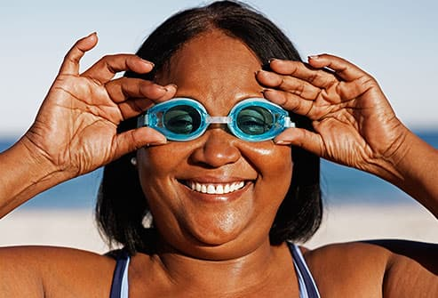 senior woman wearing swim goggles