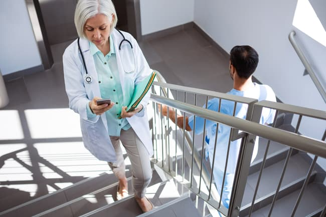 photo of doctor climbing stairs