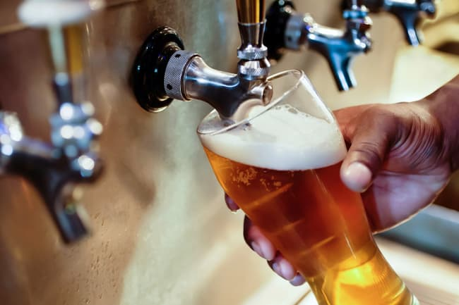 photo of pouring beer on tap