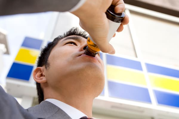 photo of man sipping energy drink